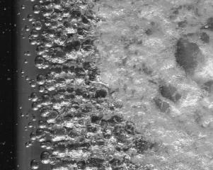 Control of Cloud Cavitation through Microbubbles